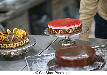 chef preparing desert cake in the kitchen - Closeup of a...