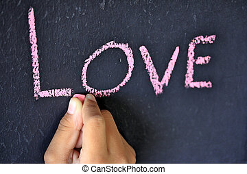 The word love written on a blackboard