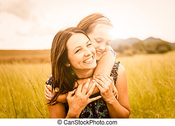 Mother and child hugging - Mother and child are hugging and...