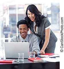 Businesswoman helping her colleague in office