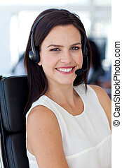 Portrait of a smiling businesswoman in a call centre -...