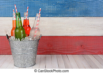 Soda Bucket Horizontal - A bucket of soda bottles with...