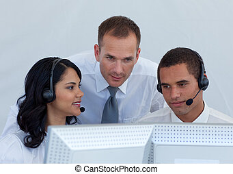 Manager helping business people in a call canter