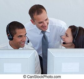 Manager and business people in a call canter
