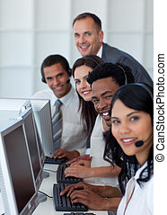 Business team and manager working in a call center -...