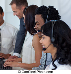 Business team working in a call center with a manager -...