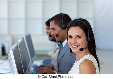 Smiling businesswoman in a call canter - Smiling beautiful...