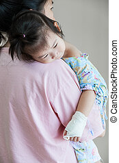 Illness child in hospital, saline intravenous (IV) on hand...