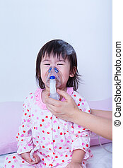 Doctor helps little girl to do inhalation - Doctor helps...