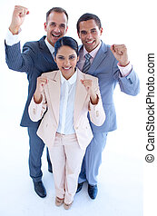 Happy business team celebrating a success with arms up -...