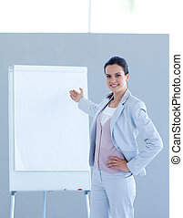 Beautiful businesswoman giving a presentation - Smiling...