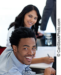 Smiling Afro-American businessman in a meeting