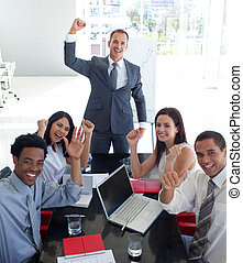 Business people in a meeting celebrating a success - Happy...