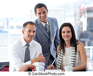 Business people working together and smiling at the camera -...