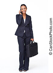 Smiling Indian businesswoman on phone going to work