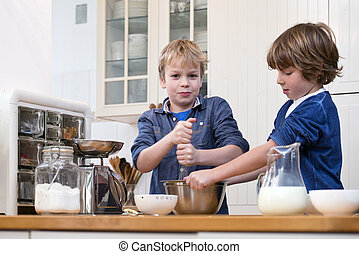 Boys baking pastry - Two boys whisking dough for pastry in a...