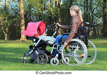 Mother in wheelchair with pram in a Park