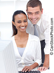 Businessman and businesswoman working together in office