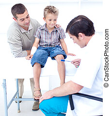 Doctor checking a patient reflexes - Doctor checking a...