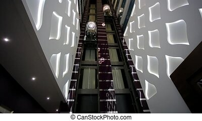 Elevators in the lobby - Lifts in the hall of the hotel