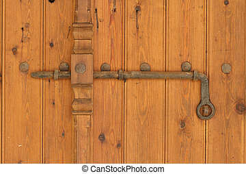 Vintage rusty deadbolt on the old wooden door. horizontal -...