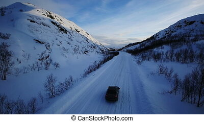 Winter Driving - Winter Road Country road leading through a winter mountain landscape.