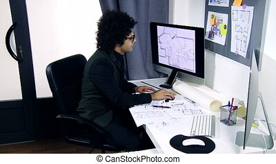 Cool handsome architect working on project in office wide...