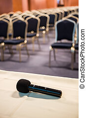 Vertical shot of microphone and auditorium