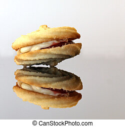 Viennese whirl biscuits on glass with reflection