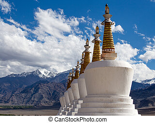 Buddhist chortens (stupa) and Himalayas mountains in the...