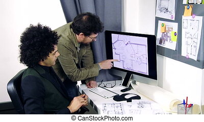 Two architects working on project