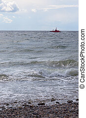supply ship - Red supply ship off the southern tip of the...