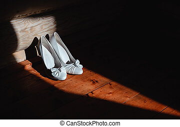 bridal shoes - Elegant white shoes of the bride in the beam...