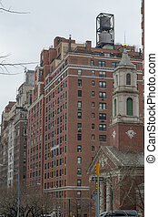 Water tower by a church - Water tower are iconic in NYC and...