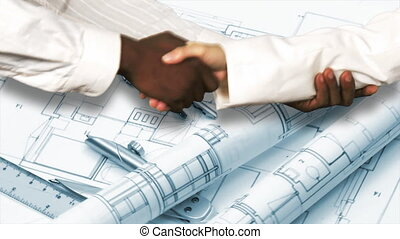 Two architects shaking hands - Close-up of two architects...