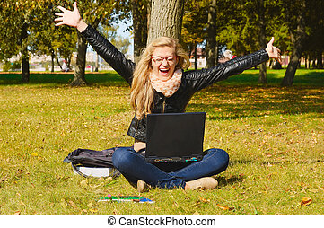 pretty excited girl with a laptop