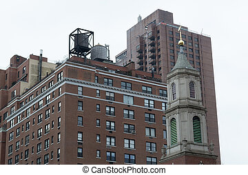 Wtertowers by a church - Water tower are iconic in NYC and...