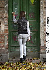Great Expectations - Teenager girl knocking at the old door