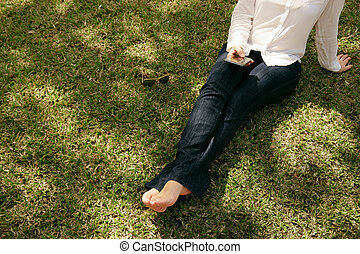 High Angle Woman Texting Mobile Phone Sitting Grass Park -...