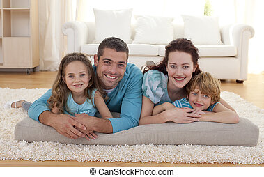 Family on floor in living-room - Family on floor lying in...