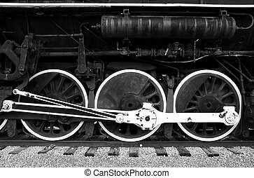 Large wheels of an old steam engine
