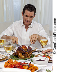 Man eating turkey in Christmas dinner