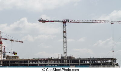 Construction site with cranes - Construction site with...