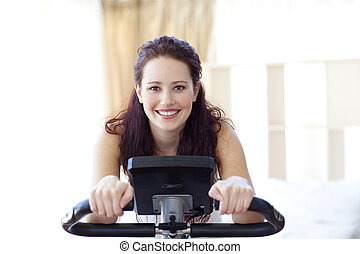 Smiling woman doing spinning at home - Smiling woman doing...