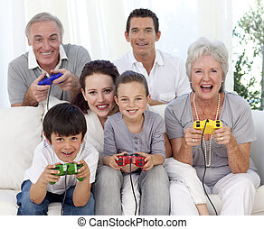 Family playing video games at home - Grandparents, parents...