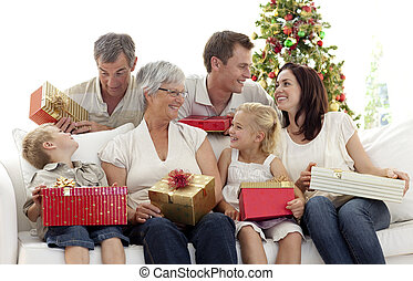 Family giving presents for Christmas