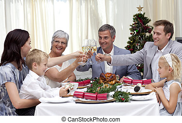 Family drinking a toast at their Christmas dinner