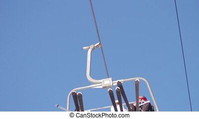 Ski lift with people - People rise up the mountain on the...