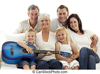 Portrait of family playing guitar at home - Portrait of...