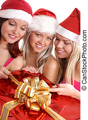 Christmas group portrait. Three young attracive girls with...
